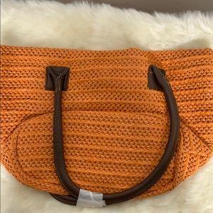 NWOT Orange faux wicker looking bag/ brown handles